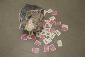 <i>elvissa (ibiza)</i>, 2010 </br> found stone from ibiza, spanish playing cards, variable dimensions