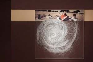 <I>unravelling the universe</I>, 2011 </br>  cut photographs, plexiglass, painted wall </br> 122 x 122 x 2 cm / 48 x 48 x 0.8 in