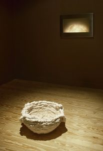 inscape / becoming, 2011, (in foreground) white clay, sourdough crust coats interior, 26 x 56 cm / 10.2 x 22 in (on wall), corian lithophane, steel frame, light electronics, 50 x 76 x 5 cm / 19.7 x 29.9 x 2