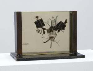 <i>fossile del 2000 (fossil from 2000)</i>, 1959 </br> plexiglass and metal, 13 x 16 cm / 5.1 x 6.3 in