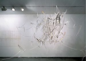 <I>vanishing points: light piece with light</I>, 2001 </br> cut out photographs, thread, glue, 300 x 300 cm / 118.1 x 118.1 in