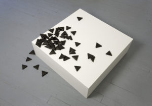 <i>les petites lettres</i>, 2009</br>48 pieces of paper dyed with black chinese ink, mdf pedestal</br>86 x 86 x 27 cm / 33.9 x 33.9 x 10.6 in