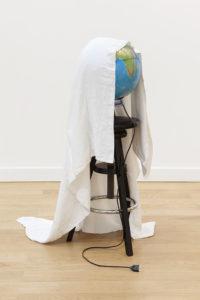 <i>fantome</i>, 2014 </br> wood stool, worldmap, textile </br> 113 x 36 x 36 cm / 44.4 x 14.1x 14.1 in