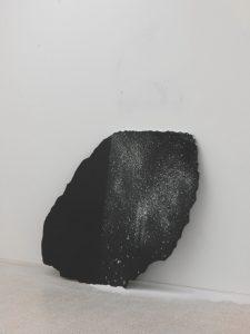 <i>immagine seme (seed-image)</i>, 2010 </br> black belgian marble, wall-dust,  140 x 145 x 2 cm / 55.1 x 57.1 x 0.8 in