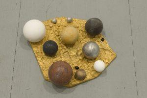 <i>principio (beginning)</i>, 2008 </br> golden bronze, aluminum, marble, bronze, seeds, 15 x 22 x 28 cm / 5.9 x 8.7 x 11 in