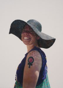 <i>woman with straw hat and feminist fist tattoo </br>