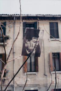 <i>melancolia, ovvero trasparente (melancholia, namely transparent)</i>, 1995 </br> photograph on acetate, nylon thread, clips, 21 x 30 cm / 8.3 x 11.8 in