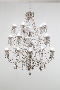 <i>platinum chandelier</i>, 2004 </br> 3 tier platinum chandeliers, glazed ceramic, mixed hardware </br> 122 x 84 cm / 48 x 33 in