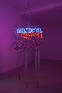 <i>radical hospitality</i>, 2015</br>stainless steel, aluminium tubes, wood, chain, 4 neon signs with cable and 2 power sources</br>300 x 100 cm / 118 x 39.4 in