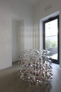 better places , 2011 mirror, aluminium thread, painted paper and vinyl, diam.123 cm, height variable, 145 pieces