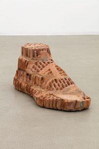 judith hopf, brick-foot, 2016 bricks, cement, red clay, 31 × 78 × 33 cm