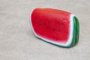 nicolas party, blakam's stone (watermelon), 2015 acrylic on stone, 23 x 36 x 13 cm