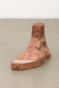 judith hopf, brick-foot, 2016 bricks, cement, red clay, 37.5 × 61.5 × 25 cm
