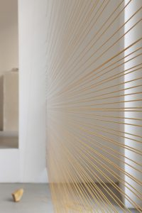 <i>tessitori di albe (weavers of sunrises)</i>, 2010</br>yellow persian marble, synthetic thread</br> variable dimensions