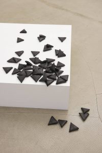 latifa echakhch, les petites lettres, 2009 48 pieces of paper dyed with black chinese ink, mdf and paper pedestal, 86 × 86 × 27 cm