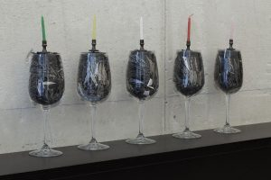 maggie cardelús, happy birthday to me, 2012 wine glass filled with x-acto blades, brass candle holder, birthday candle, 30 x 8 cm each