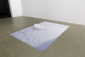 <i>sotto la superficie, la verità della concretezza (trentino)</br>(under the surface, the truth of concreteness (trentino)</i>, 2013</br>print on blueback paper, carrara's marble</br>16 x 224 x 150 cm / 6.3 x 88.1 x 59 in