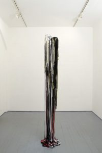 eva rothschild, meltdown, 2009 leather, steel pins, fabric, duct tape, 280 cm h., 54 cm diam.